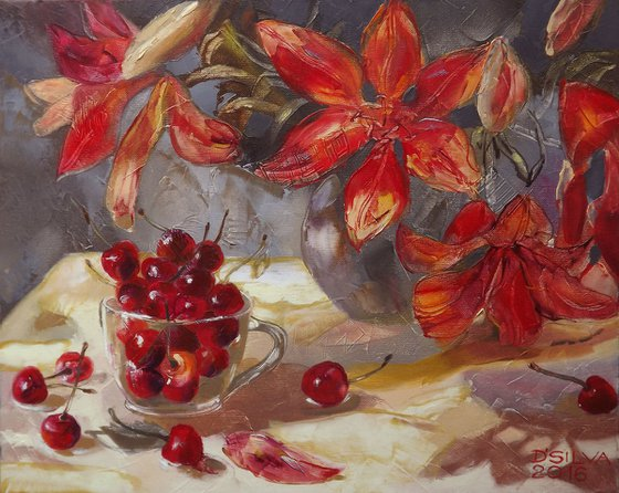 Cup with sweet cherries