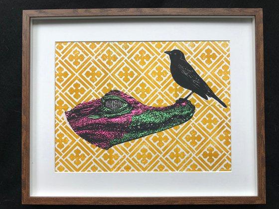 Colourful Alligator and black bird
