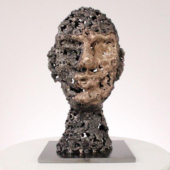A rock - Face sculpture bronze steel