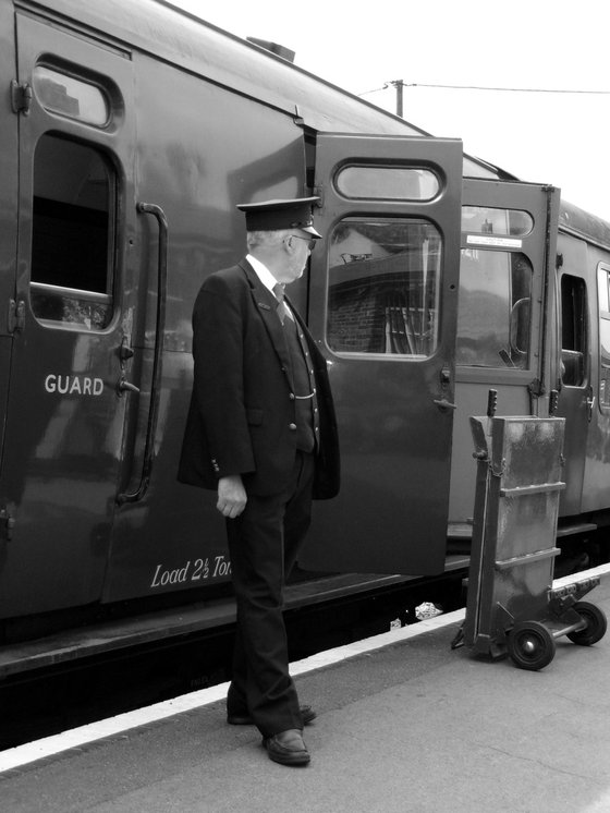 Station guard and steam train carriage