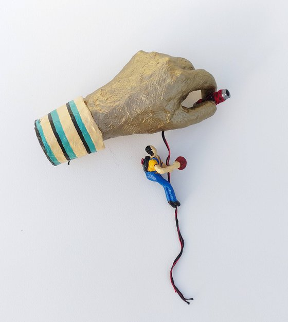 Hand holding boy - one of a kind paper sculpture