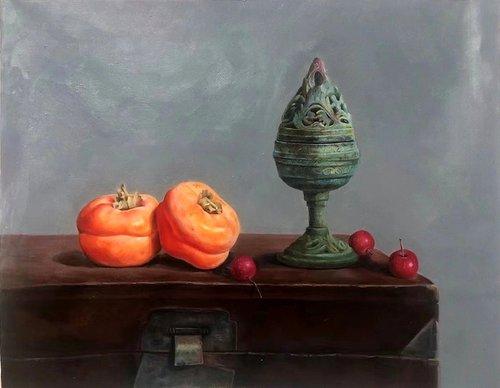 Still life:Chinese ancient kerosene burner and fruits