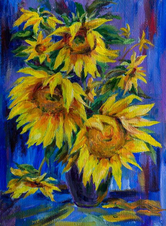 Sunflowers on blue