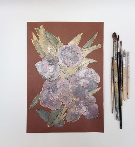 Mauve orchids on brown background