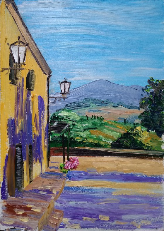 Evening Tuscany landscape with long shadows