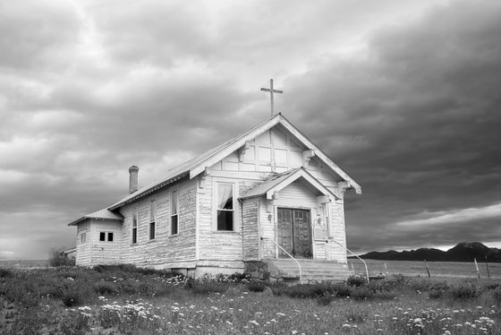 Black and white of an old country church.
