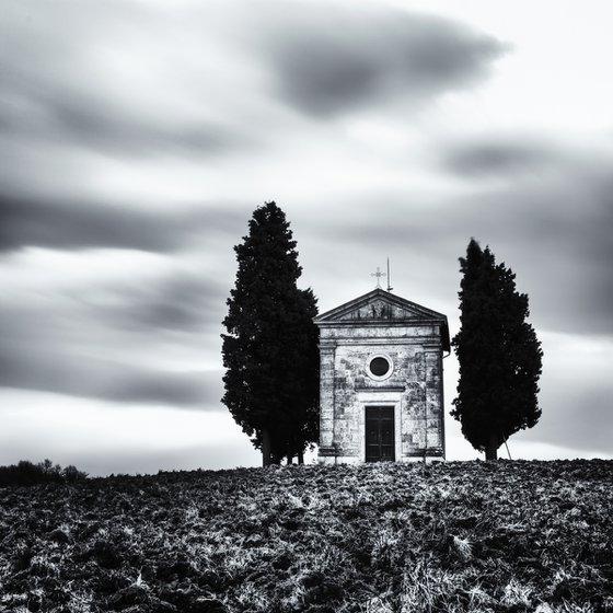 A small chapel with cypresses