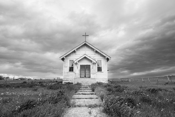 Black and white photo of old church.