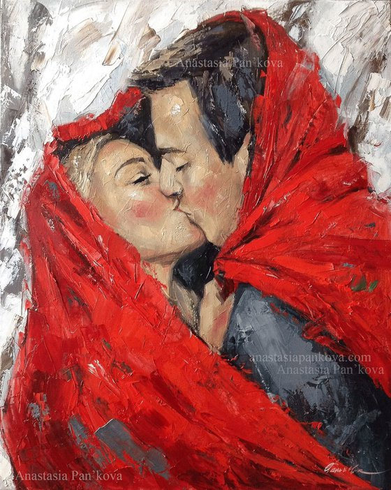 Couple under red rug