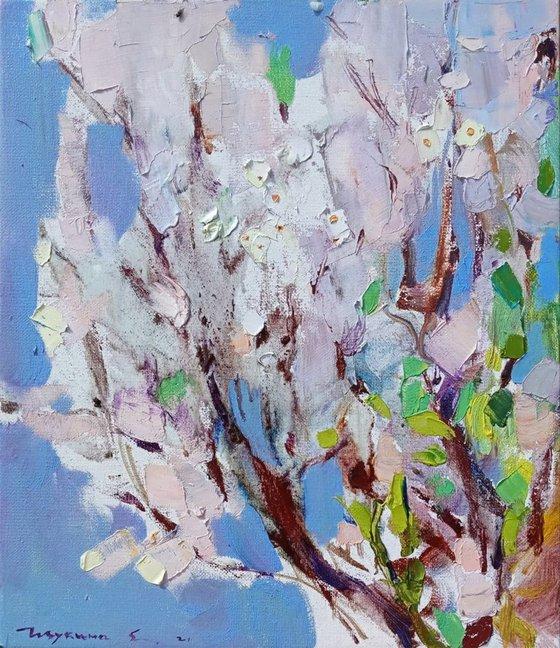 Blooming tree on blue. Original oil painting