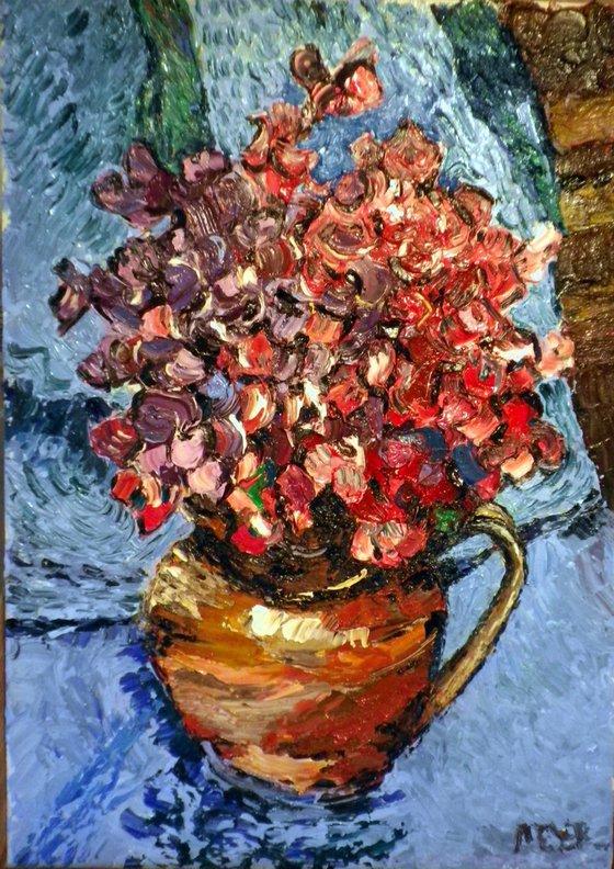 Sweetpeas in an earthenware jug