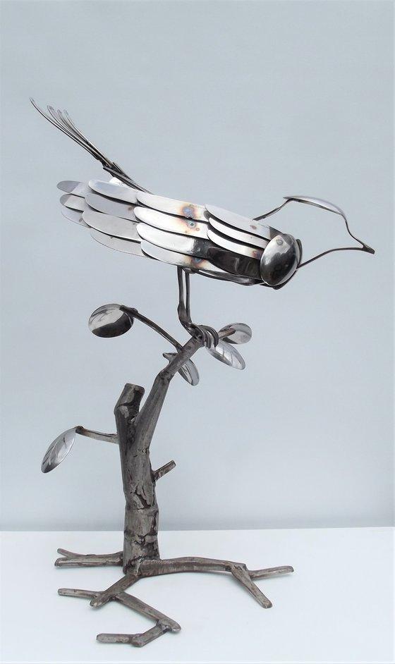 Bird in cutlery