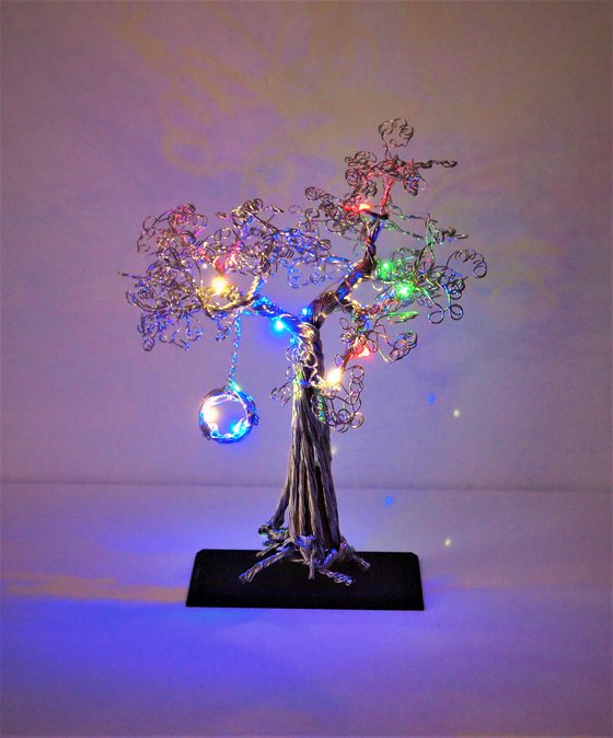 Silver wire tree sculpture with LED lights