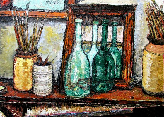 Bottles and brushes on a shelf with a mirror