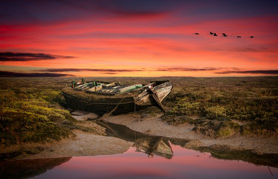 derelict barge at sunset