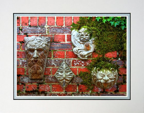 Faces on a wall sculpture