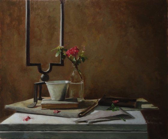 Still life with books and a flower
