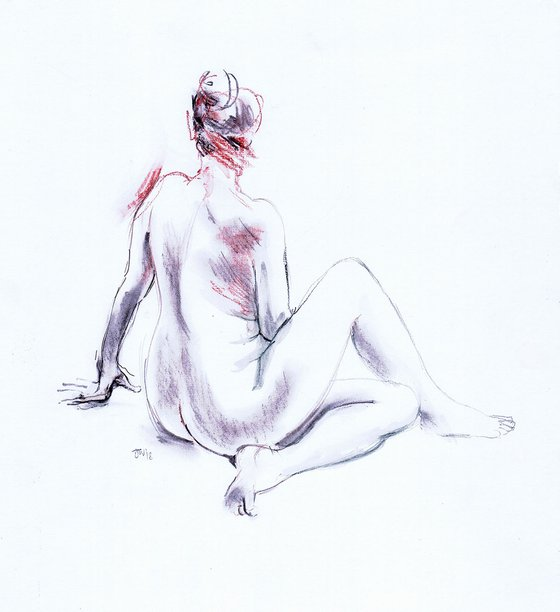 Nude seated on floor, back view