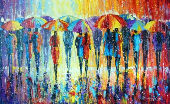 Lovers notice not rain, but multi-colored umbrellas