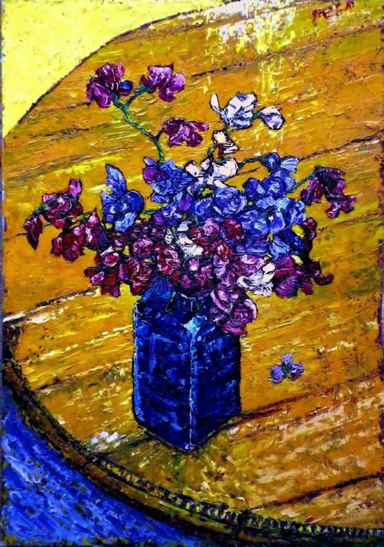 Sweetpeas in blue glass with an Iris