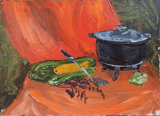 Сauldron and zucchini. Still life