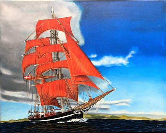 Schooner at sail away from storm