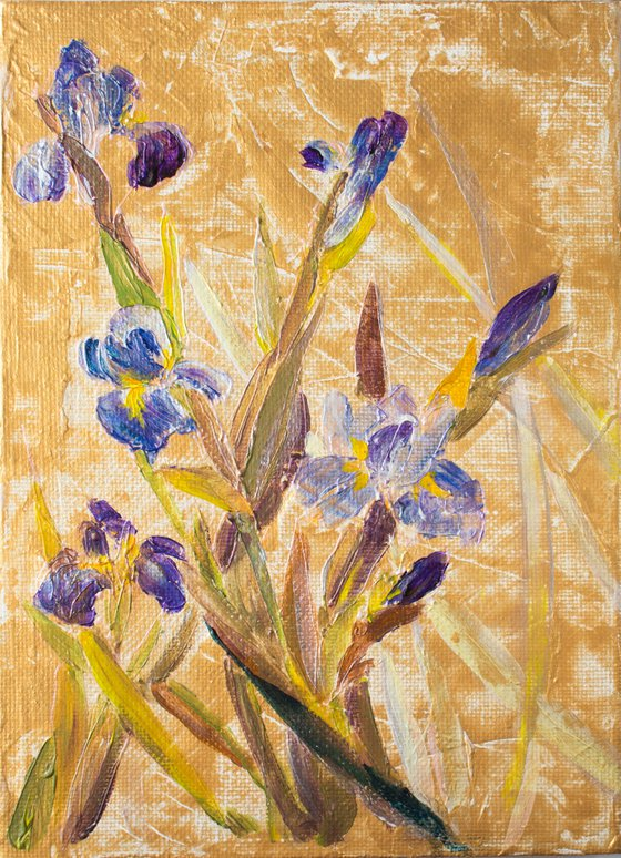 Blue irises and golden sky