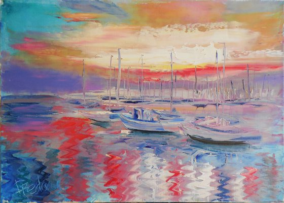 Sunset in the yachts harbor