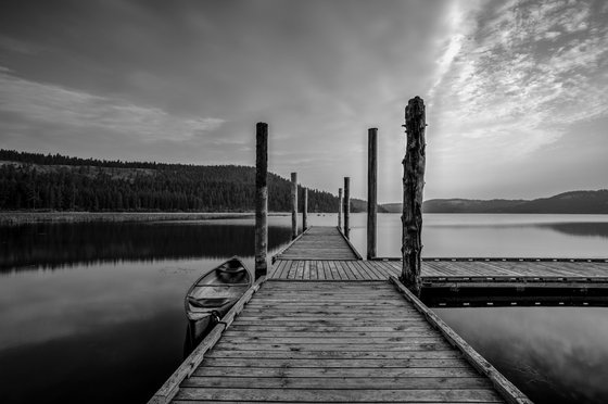 Dock at calm, tranquil lake.