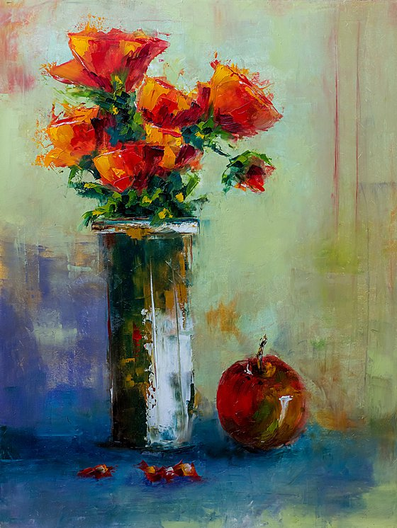 Still life with red roses an apple
