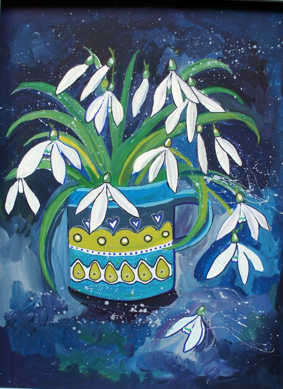 Snowdrops in a patterned cup