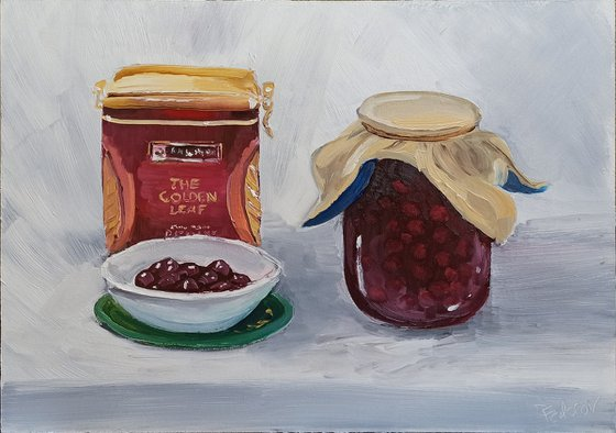 Still life with the cherry jam and the tea box