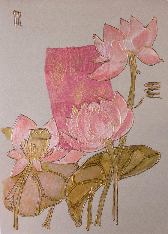 Pink lotus flowers on silver