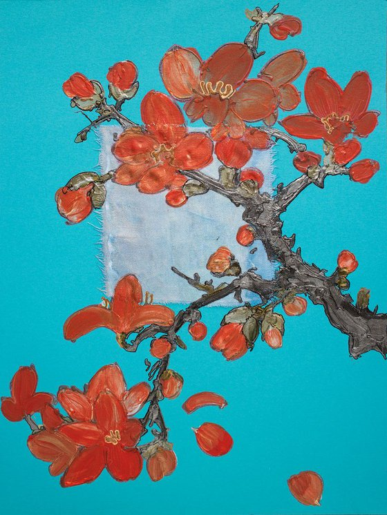 Bright red spring blossoms on azure blue sky