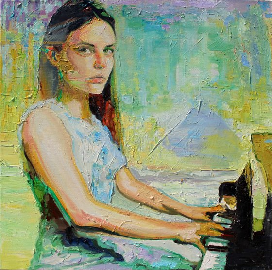 Girl sat at a piano