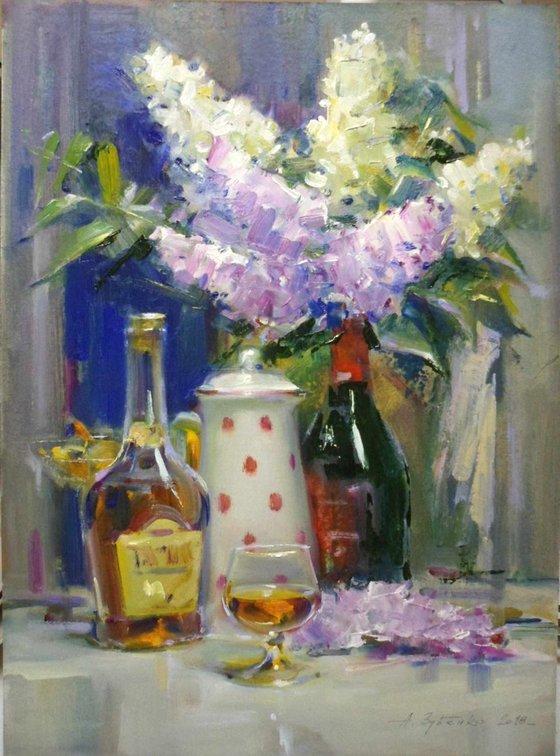 Cognac and lilac still life