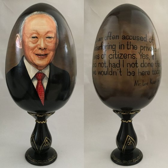Portrait and quote of Lee Kuan Yew. Painted on wooden egg. Lacquered art technique.