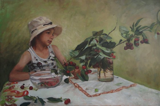 A young boy with cherries