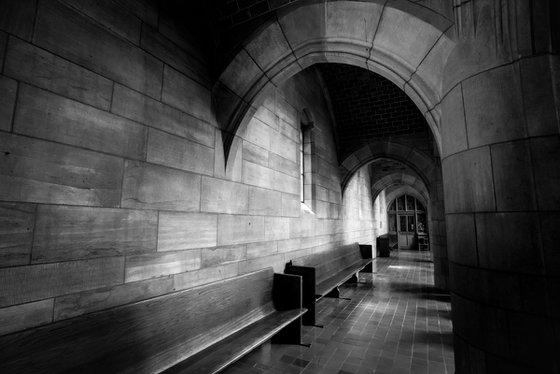 Benches along the corridor in a church.